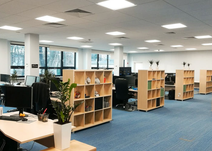 Poland office, open layout with bookshelves