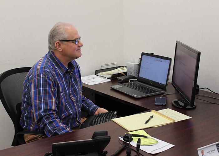 PCMI Employee Jim working at desk