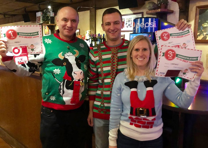 PCMI Employees wearing ugly Christmas sweaters