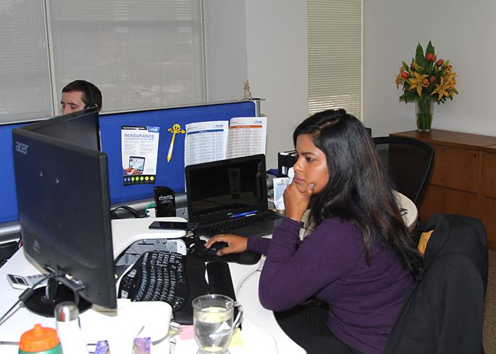 Prudhvi working at her desk