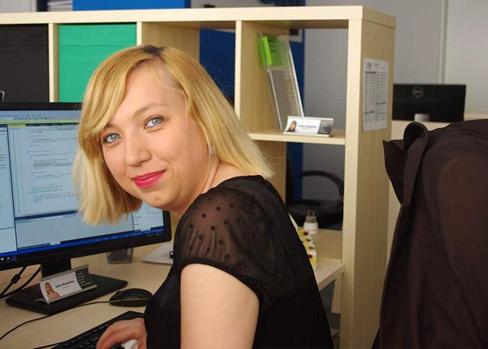 Poland team Sylvia working at desk