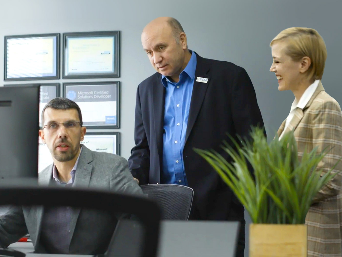 Leadership employees dicussing business around computer